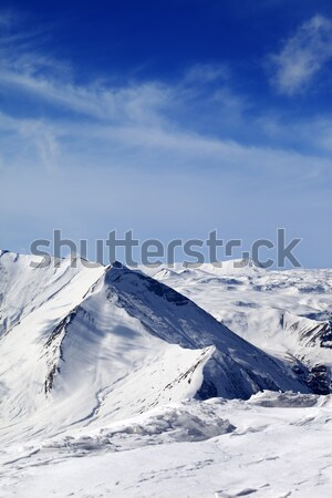 Ski slope and beautiful snowy mountains Stock photo © BSANI