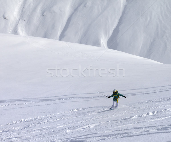 Snowboarder downhill on off piste slope with newly fallen snow Stock photo © BSANI