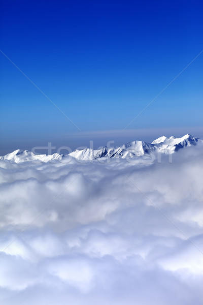 Cloudy mountains at nice winter day Stock photo © BSANI
