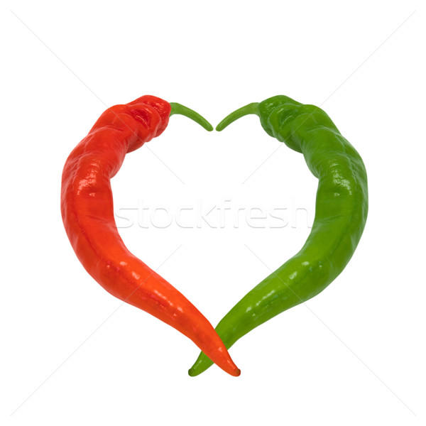 Stock photo: Red and green chili peppers in love