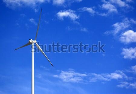 Aerogenerador cielo azul nubes sol día paisaje Foto stock © BSANI