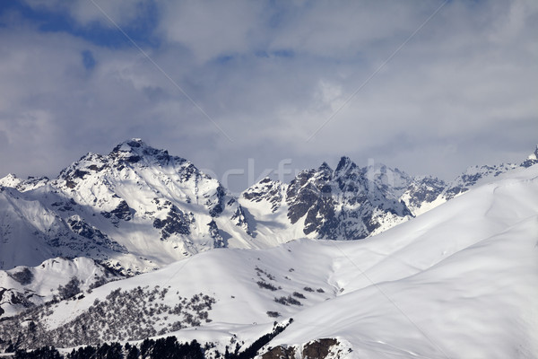 Snowy off-piste slope and mountains in clouds Stock photo © BSANI