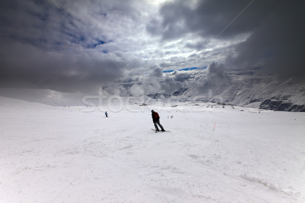 Skiers on ski slope before storm Stock photo © BSANI
