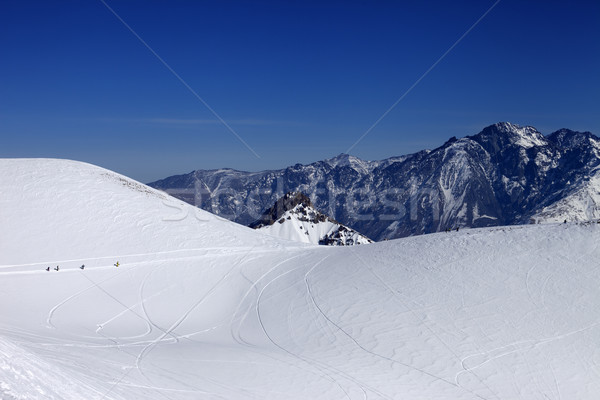 Stock photo: Snowboarders move on footpath to off piste slope at sun day