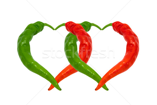 Stock photo: Red and green chili peppers in love. Hearts composed of hot pepp