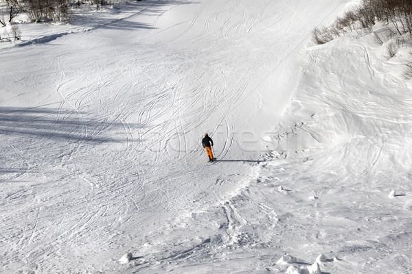 Skier on ski slope at sun winter day Stock photo © BSANI
