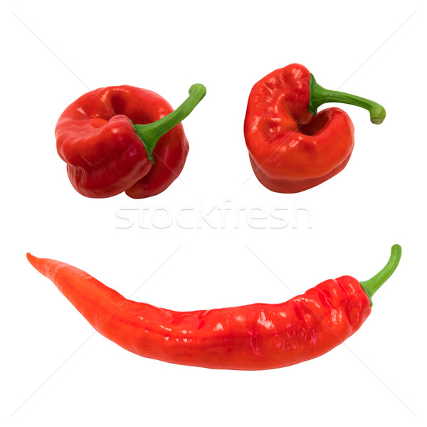 Red chili peppers in smile Stock photo © BSANI