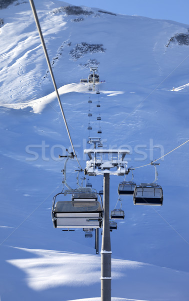 Chair-lift at early morning after snowfall Stock photo © BSANI