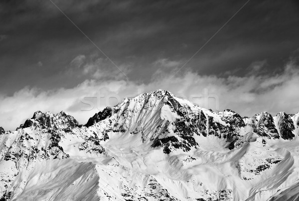Black and white snow mountains in winter sun day and sky with cl Stock photo © BSANI