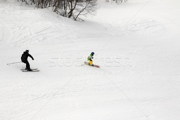 Skiers on ski slope at winter day Stock photo © BSANI