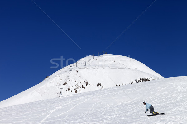 Snowboarder at the ski resort in nice day Stock photo © BSANI
