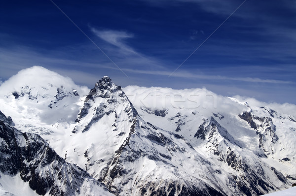 Snowy mountains and blue sky with clouds Stock photo © BSANI