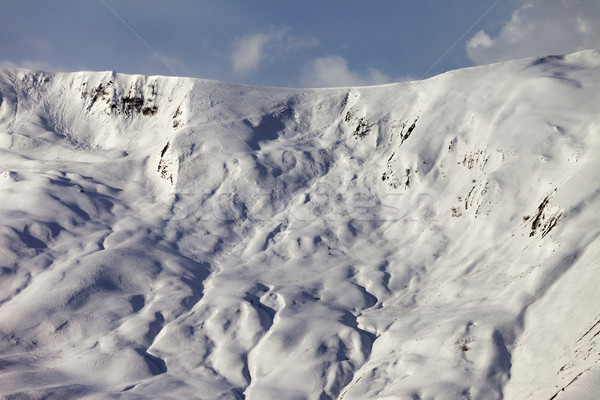 View on off-piste snowy slope at evening Stock photo © BSANI