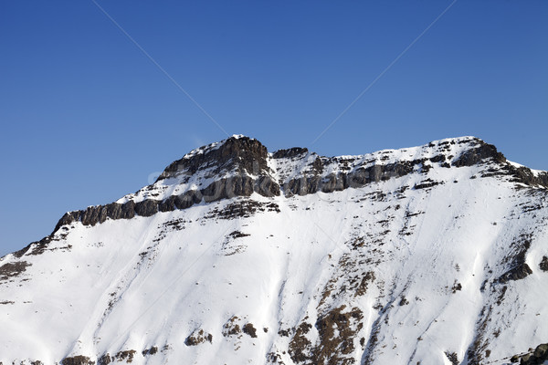 Snowy rocks with traces of avalanches Stock photo © BSANI