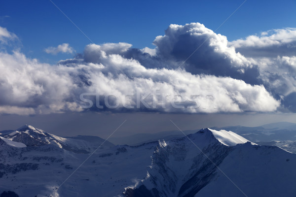 Winter mountains in nice evening and sunlight clouds Stock photo © BSANI