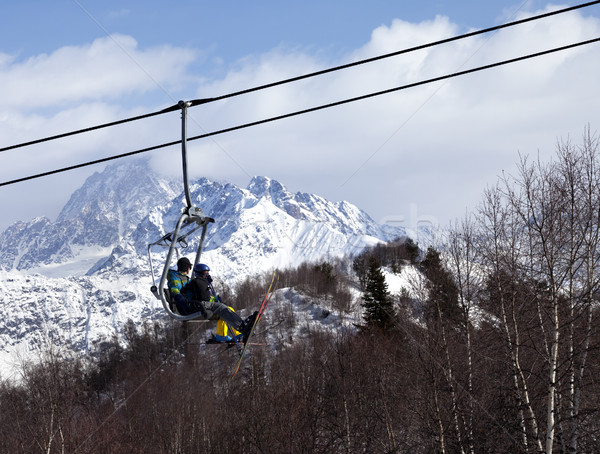 Father and daughter on ski-lift at winter sun day Stock photo © BSANI