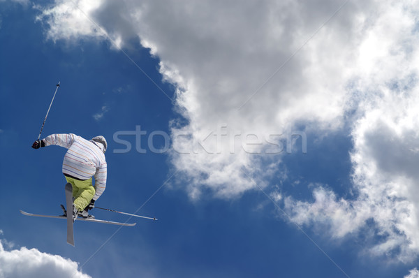 Freestyle ski jumper with crossed skis Stock photo © BSANI