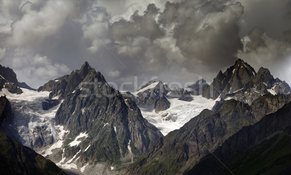 High mountains in clouds Stock photo © BSANI
