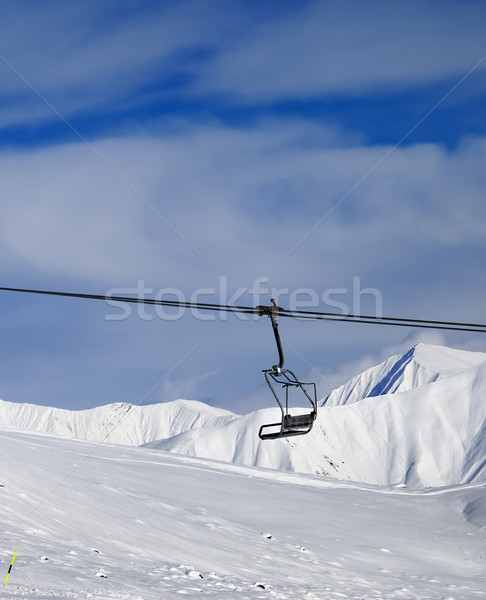 Chair lift and off-piste slope at nice sun day Stock photo © BSANI