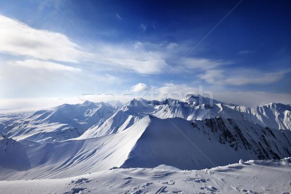 Snowy mountains and sunlight sky Stock photo © BSANI