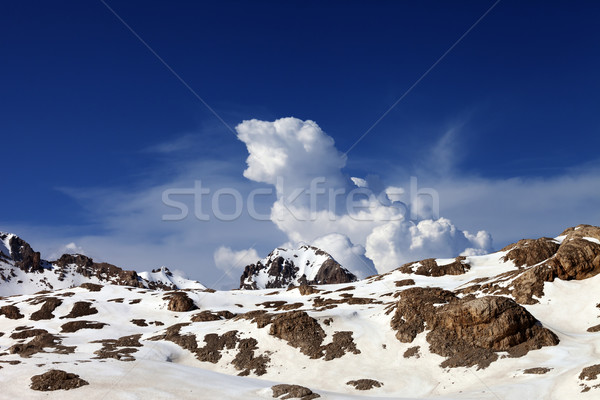 Snowy rocks and sky with clouds at nice day Stock photo © BSANI