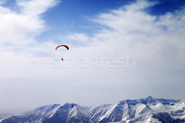 Paraglider silhouette of mountains in windy sky Stock photo © BSANI