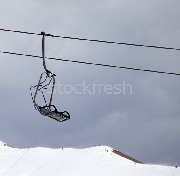 Chair lift and off-piste slope at gray windy day Stock photo © BSANI