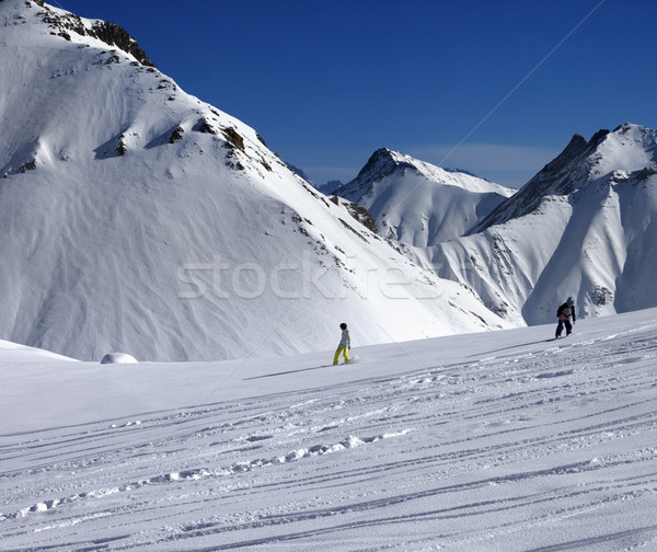Snowboarders downhill on off piste slope at sun day Stock photo © BSANI