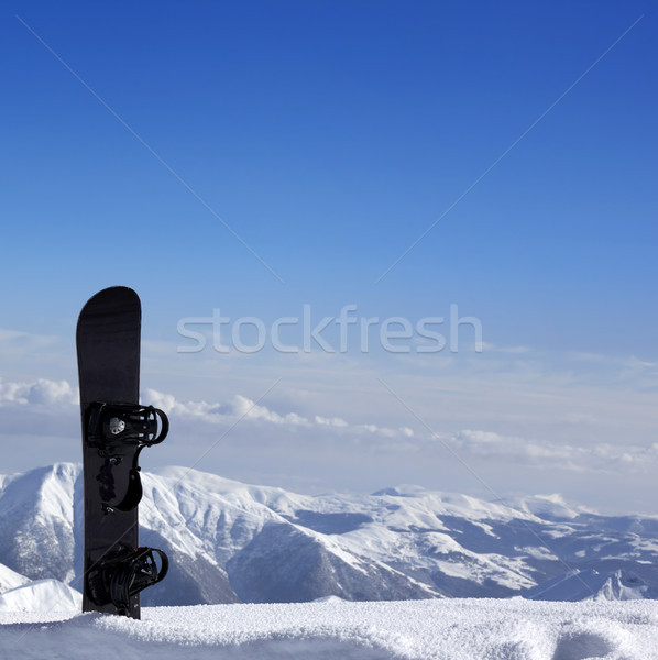 Snowboard in snow near off-piste slope in sun day Stock photo © BSANI