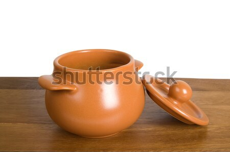 Kitchen clay pot on the wooden board Stock photo © BSANI
