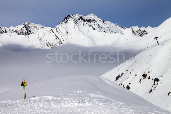 Stock photo: Warning sing on ski slope