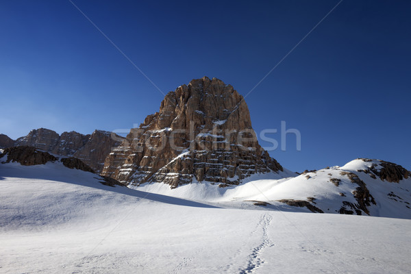 Snowy plateau and footpath against rock and blue sky in nice day Stock photo © BSANI