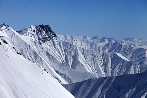 Snowy winter mountains in haze Stock photo © BSANI