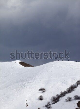Off-piste slope and overcast gray sky in windy day Stock photo © BSANI