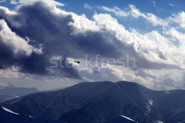 Stockfoto: Helikopter · bewolkt · hemel · winter · bergen · avond