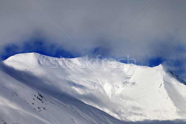 View on sunlight evening off-piste slope in mist Stock photo © BSANI