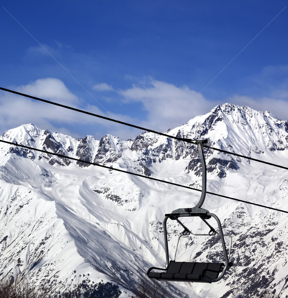 Stock photo: Chair-lift in snow winter mountains at nice sun day