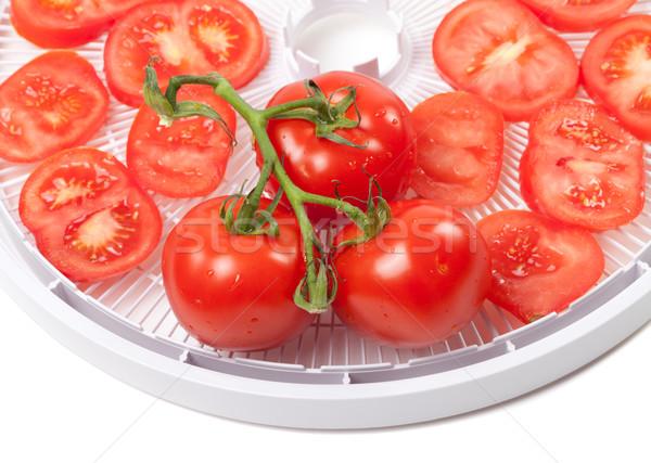 Fresh tomato on food dehydrator tray Stock photo © BSANI
