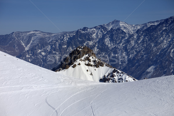 Trace from ski and snowboards on off-piste slope Stock photo © BSANI