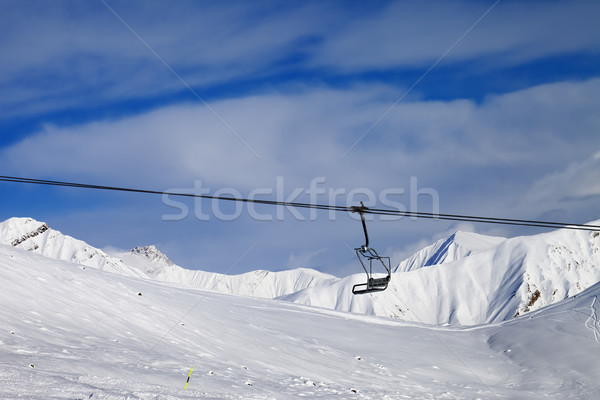 Stock photo: Chair lift and off-piste slope at nice day