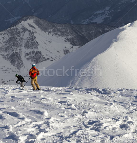 Freeriders on off-piste slope in sun nice evening Stock photo © BSANI