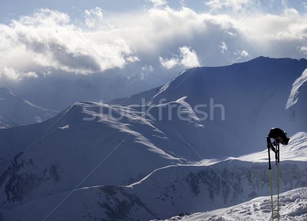 Stock photo: Evening sunlight mountains and ski equipment