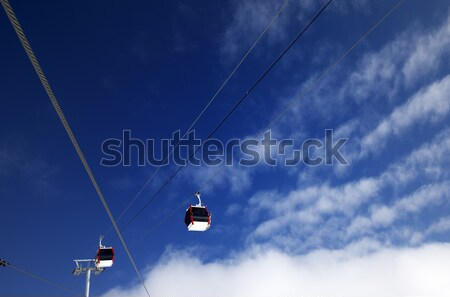 Gondola lifts at ski resort and blue sky with clouds in nice day Stock photo © BSANI