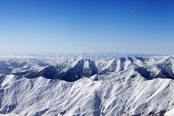 Snowy mountains and blue sky Stock photo © BSANI