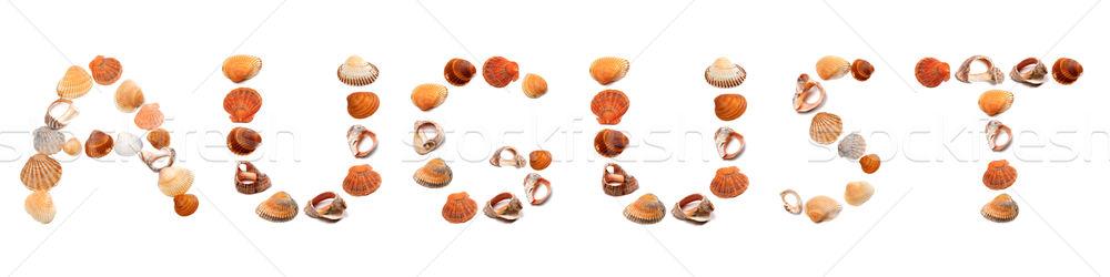 A U G U S T text composed of seashells Stock photo © BSANI