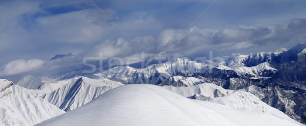 Off-piste snowy slope and cloudy mountains Stock photo © BSANI