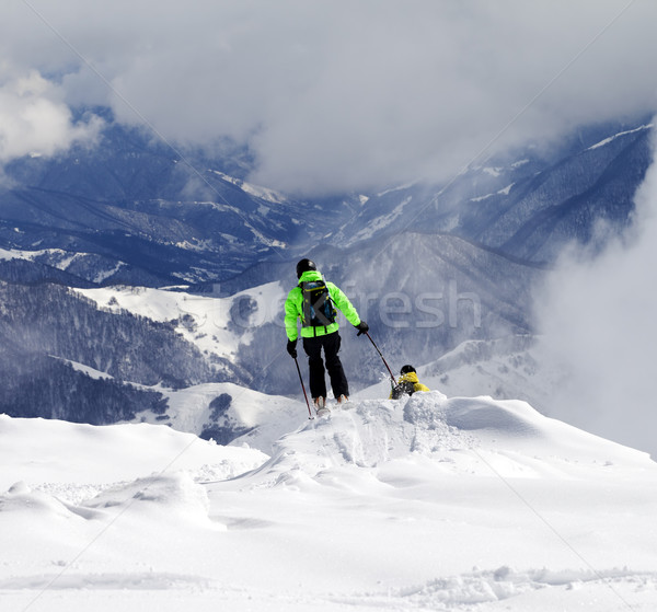 Freeriders on off-piste slope and mountains in haze Stock photo © BSANI