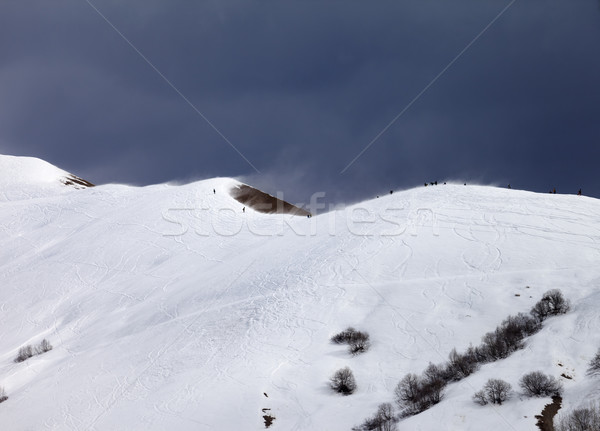 Off piste slope and overcast gray sky in windy day Stock photo © BSANI