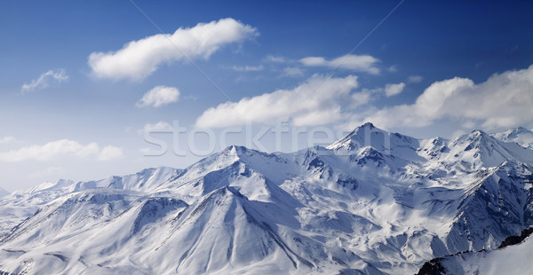 Snowy winter mountains in sun day. Panoramic view. Stock photo © BSANI