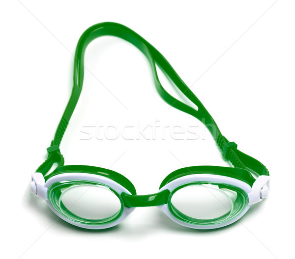 Green goggles for swimming on white Stock photo © BSANI